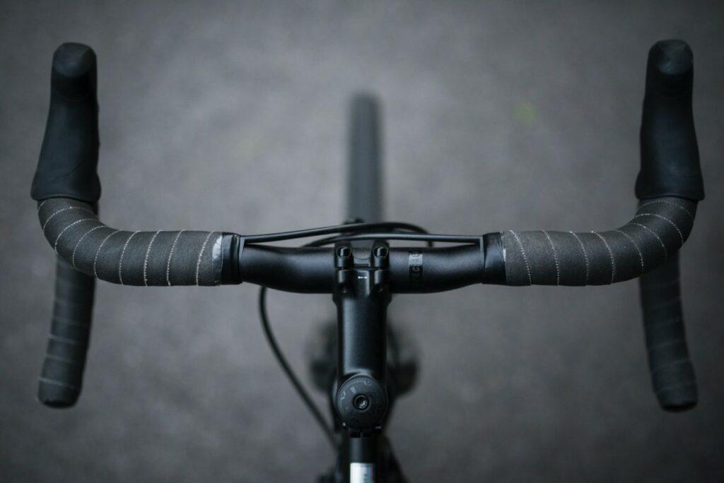 A pair of black handlebars
