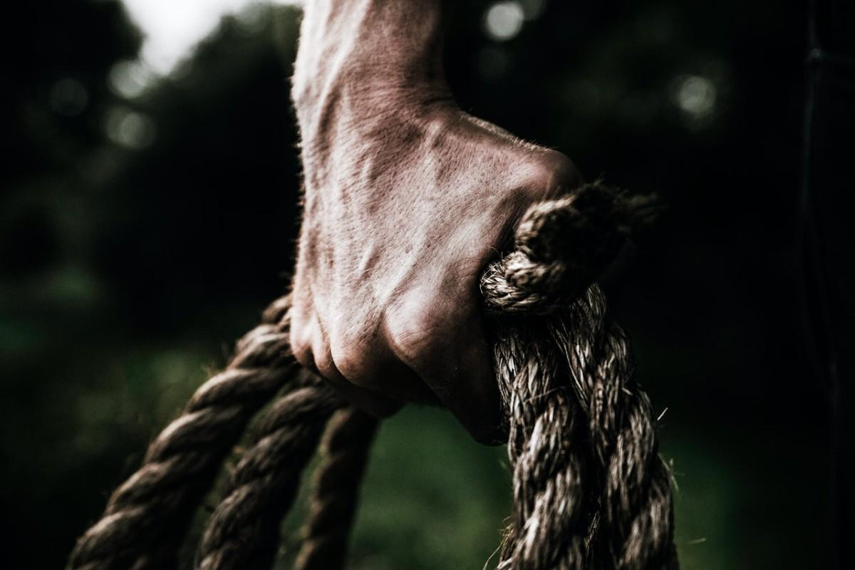 man grabbing rope