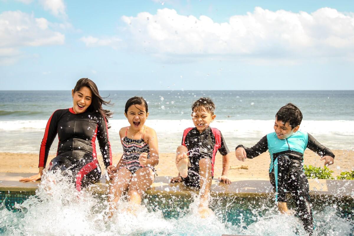 Family, on beach in Summer